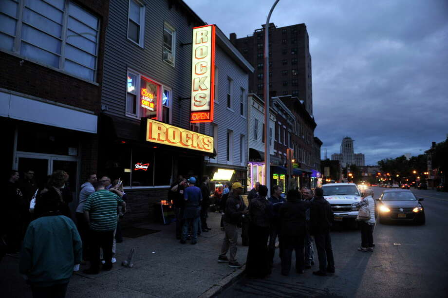 People gather to take part in a candlelight vigil outside of Rocks bar on Sunday, June 12, 2016, in Albany, N.Y.  The vigil was held to show support for those injured and to remember those killed in the mass shooting at the nightclub in Orlando, Florida.      (Paul Buckowski / Times Union)