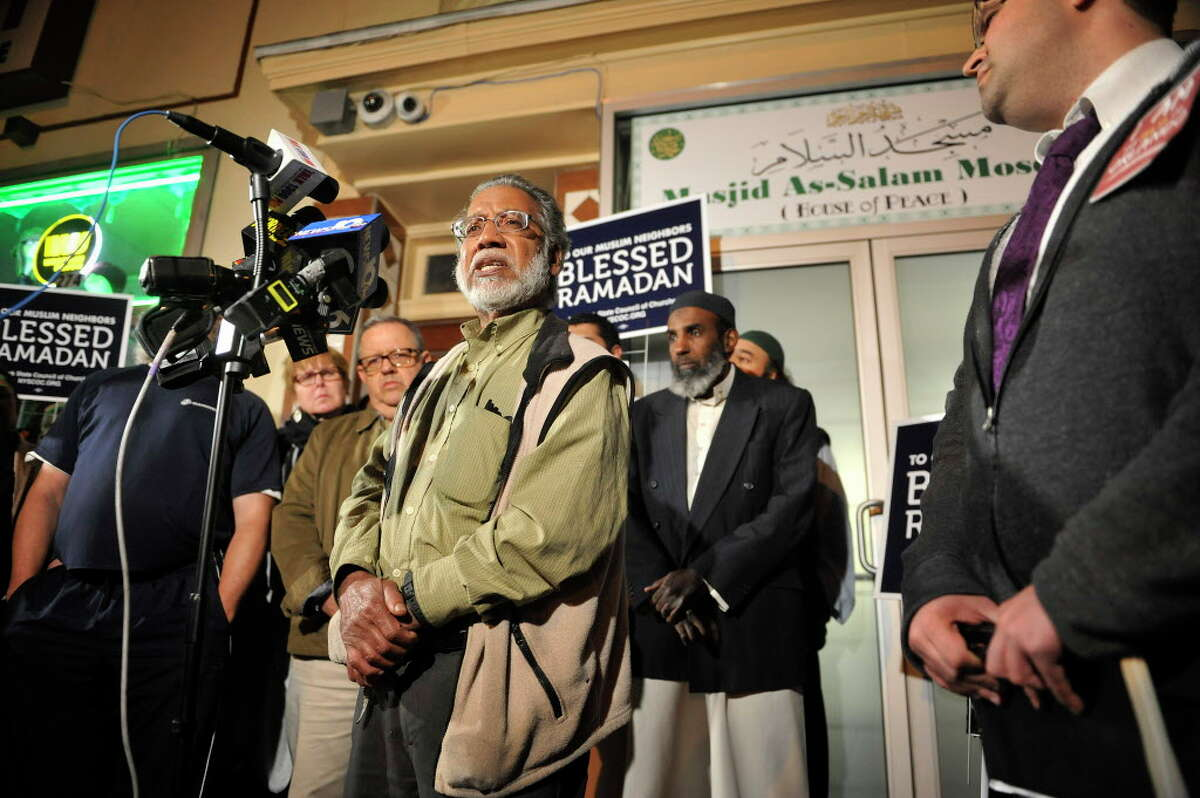 Shamshad Ahmed, president of the Masjid As-Salam Mosque, addresses those gathered for a press conference outside the mosque on Sunday, June 12, 2016, in Albany, N.Y. Members of the mosque along with City of Albany elected officials and members of area churches held the press conference to denounce the mass shooting at a nightclub in Orlando, Florida. (Paul Buckowski / Times Union)