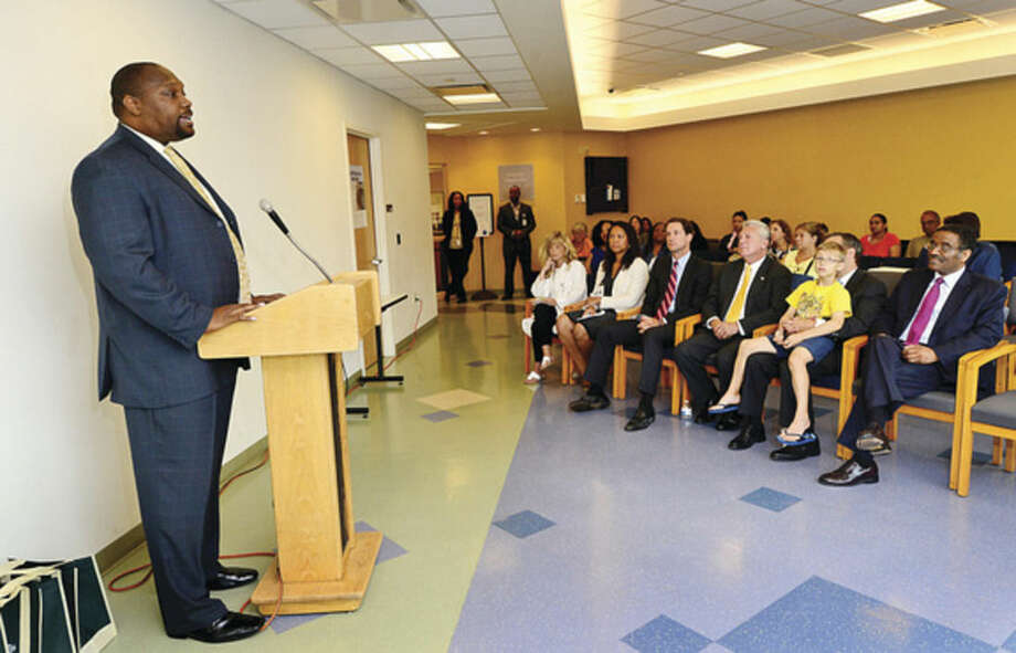 "Hour photo/Erik TrautmannNorwalk Community Health Center director Craig Glover addresses dignitaries as the center takes part in a ""National Health Center Week"" event Wednesday morning."