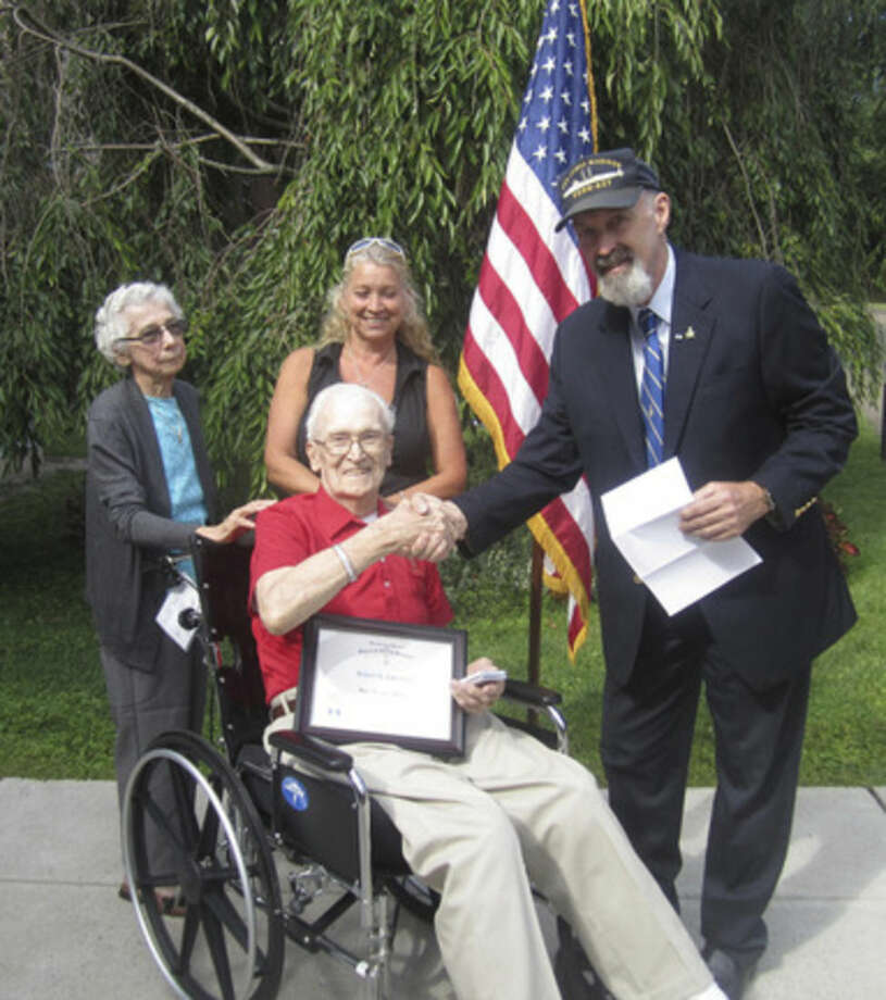Contributed photoWWII veteran Robert G. Lanehart receives a War Service Medal and Certificate from the Roger Sherman Branch, Sons of the American Revolution this week at Aurora Senior Living in Norwalk.