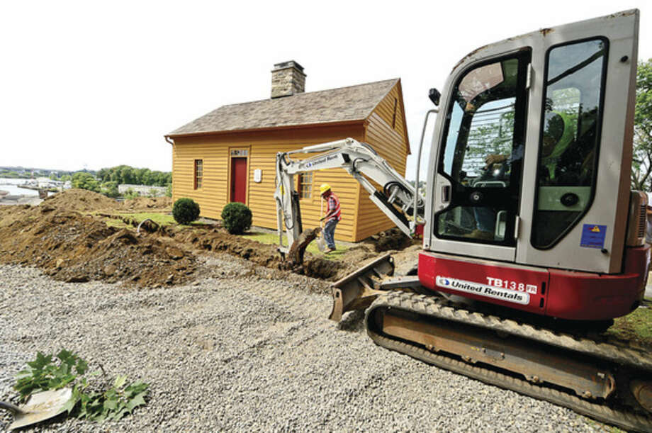 Hour photo / Erik Trautmann A construction crew begins renovations to the Mill Hill historic park to make the buildings there Handicap accessible Thursday.