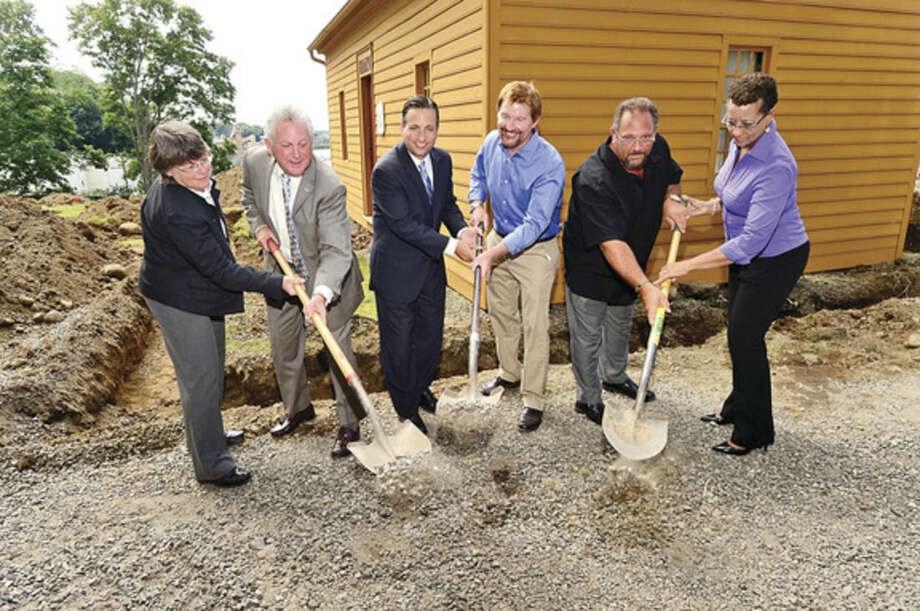 Hour photo / Erik Trautmann Patsy Gill of Gill & Gill Architects, Norwalk Mayor Harry Rilling, State Senator Bob Duff, Norwalk Historical Society president David Westmoreland, Recreation and Parks Department director Mike Moccaie and Norwalk Historical Society executive director Diane Jellerette break ground for the new handicap accessible renovations to the Mill Hill historic park during a brief ceremony Thursday.