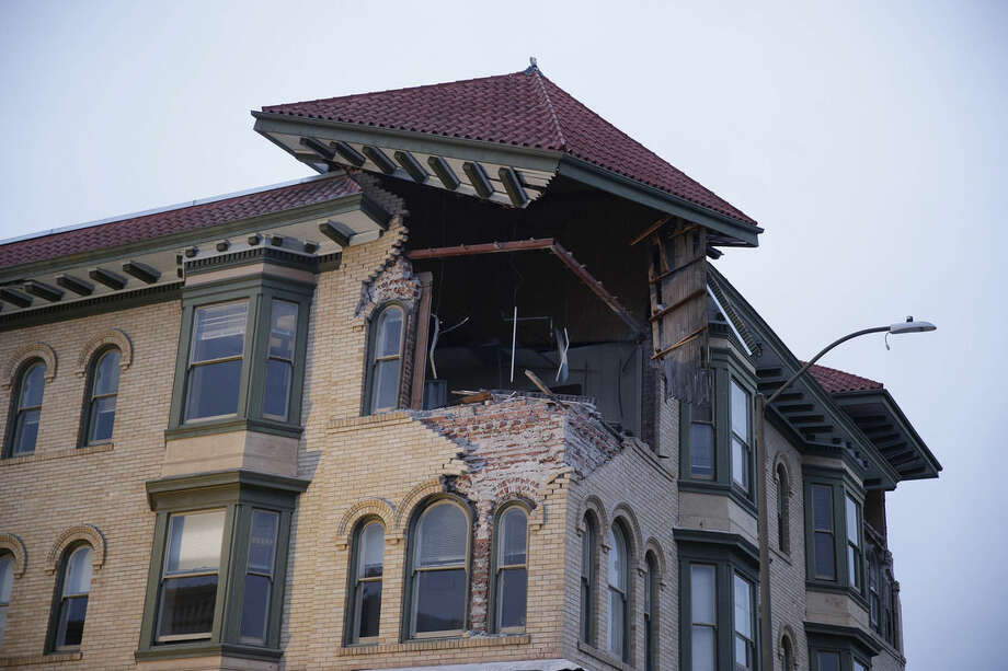 The top corner of a building is exposed following an earthquake Sunday, Aug. 24, 2014, in Napa, Calif. A large earthquake rolled through California's northern Bay Area early Sunday, damaging some buildings, igniting fires, knocking out power to tens of thousands and sending residents running out of their homes in the darkness.(AP Photo/Eric Risberg)