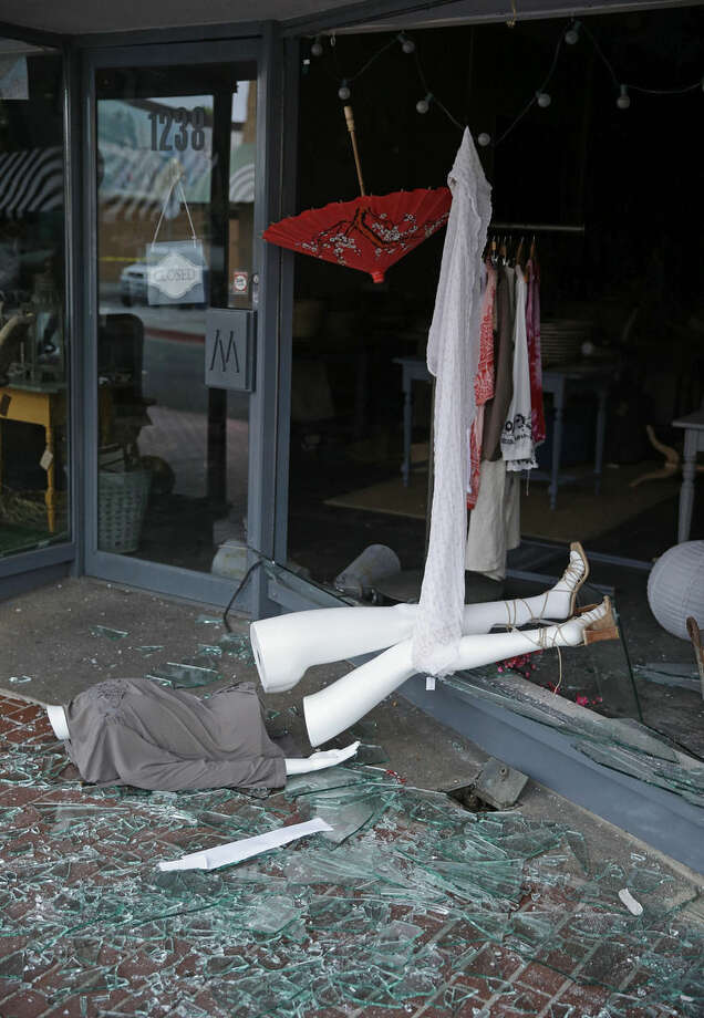 A broken mannequin and storefront window are on First Street following an earthquake Sunday, Aug. 24, 2014, in Napa, Calif. A large earthquake rolled through California's northern Bay Area early Sunday, damaging some buildings, igniting fires, knocking out power to tens of thousands and sending residents running out of their homes in the darkness. (AP Photo/Eric Risberg)