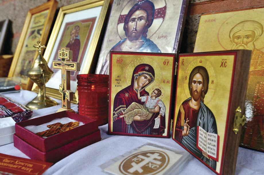 Hour photo / Erik Trautmann Iconography for sale at the St. George Greek Orthodox Chuch annual Greek Fair Saturday.