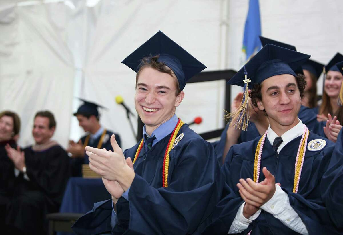 Valedictorian James Kunhardt applaudes during Weston High School's 46th Annual Commencement Ceremony on Monday June 13, 2016 at the school in Weston, Conn.