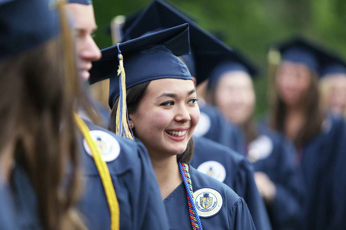 Olivia Stanley smiles at friends during Weston High School's 46th Annual Commencement Ceremony on Monday June 13, 2016 at the school in Weston, Conn.