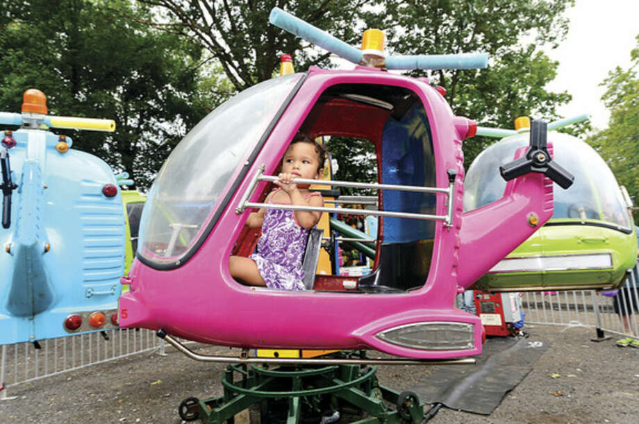 Hour photo / Erik Trautmann 2 year old alic Murphy enjoys the helicopter ride at the St. George Greek Orthodox Church annual Greek festival Saturday.