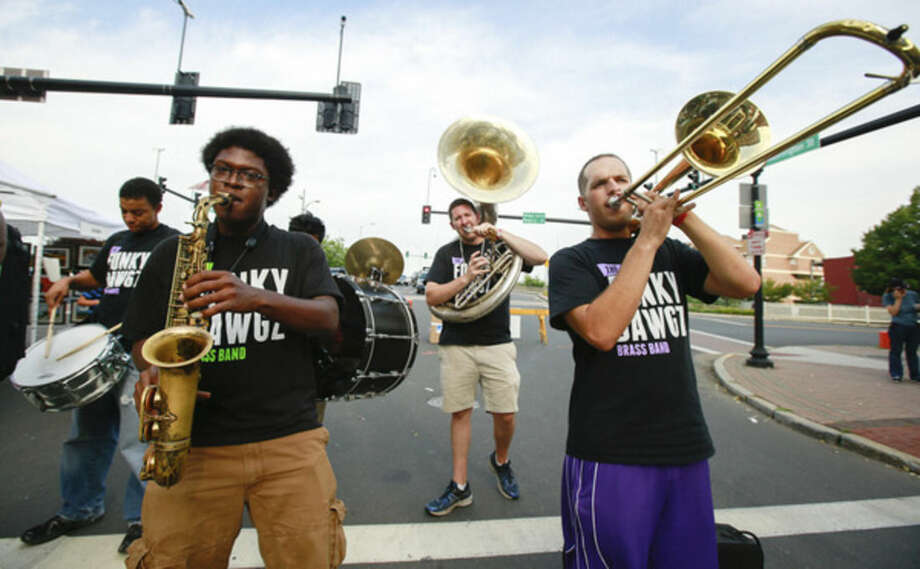 Hour photo/Chris Palermo. The Funky Dawgz Brass Band perform on Washington Street at the 39th Annual SoNo Arts Festival Saturday afternoon.
