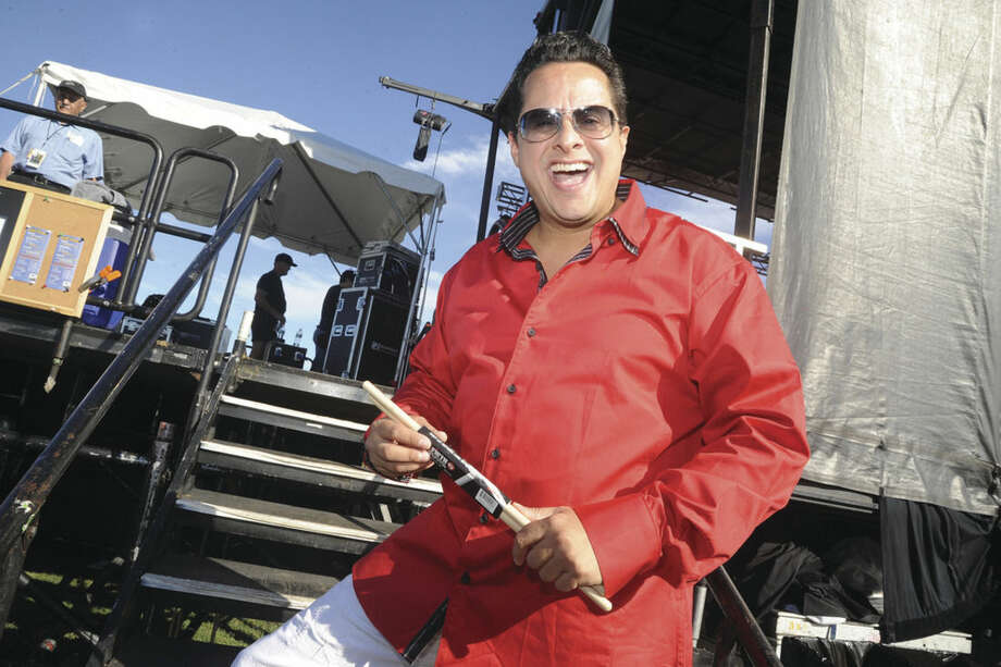 Hour photo/Matthew VinciTito Puente Jr. prepares to take the stage Sunday at the Oyster Festival.