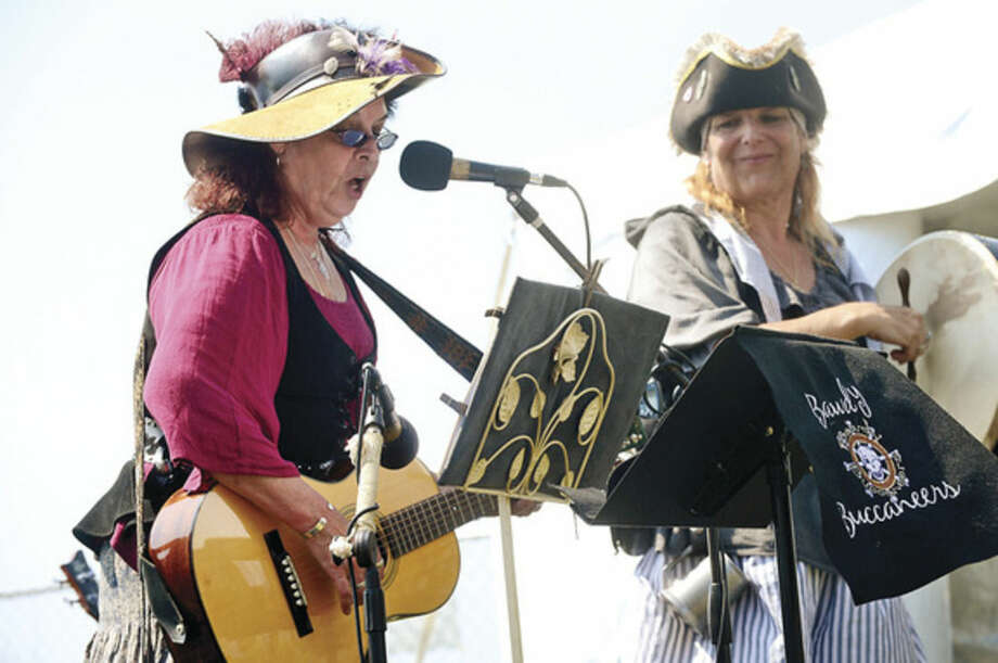 Hour photo / Erik Trautmann The Bawdy Buccaneers perform in Pirate's Cove during the Norwalk Seaport Association's 37th annual Oyster Festival at Veteran's Park Saturday.