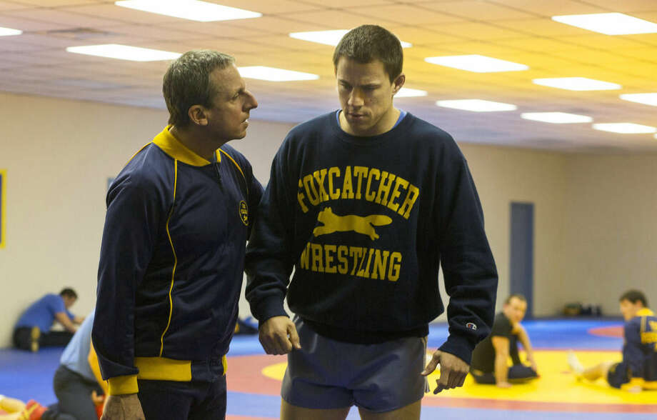 """AP Photo/Sony Pictures Classics, Scott GarfieldThis image released by Sony Pictures Classics shows Steve Carell, left, and Channing Tatum in a scene from """"Foxcatcher"""". The film, based on Olympic wrestler Mark Schultz, will be released on Nov. 14."""