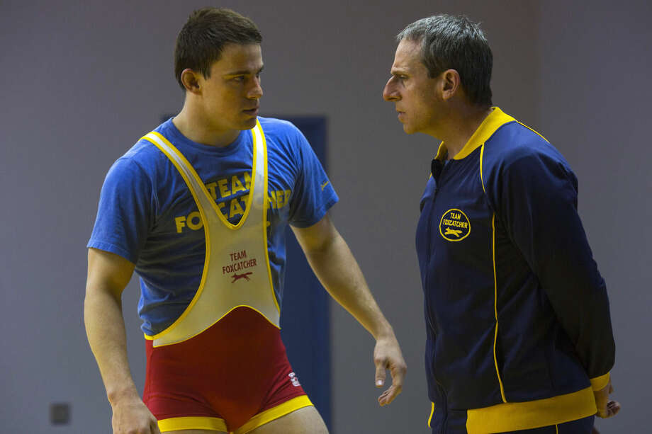 """This image released by Sony Pictures Classics shows Steve Carell, right, and Channing Tatum in a scene from """"Foxcatcher."""" The film, based on Olympic wrestler Mark Schultz, will be released on Nov. 14, 2014. (AP Photo/Sony Pictures Classics, Scott Garfield)"""