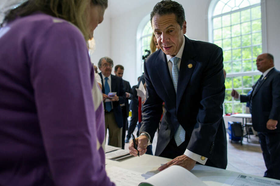 Governor Andrew Cuomo signs in to cast his vote during the primary election Tuesday, Sept. 9, 2014 at the Presbyterian Church of Mount Kisco in Mount Kisco, New York. (AP Photo/Craig Ruttle)