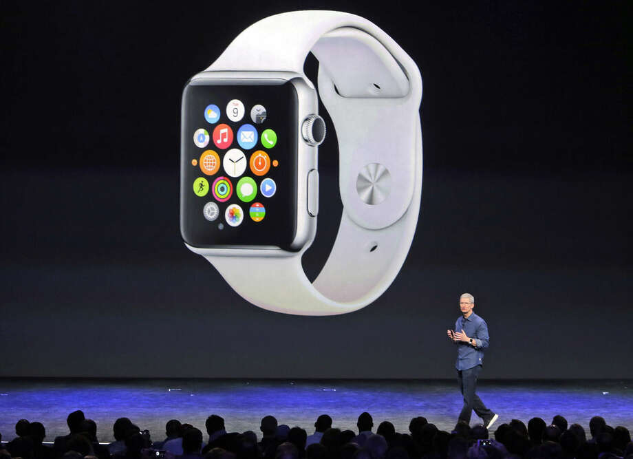 Apple CEO Tim Cook introduces the new Apple Watch on Tuesday, Sept. 9, 2014, in Cupertino, Calif. (AP Photo/Marcio Jose Sanchez)
