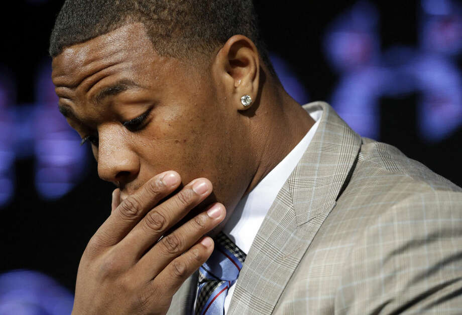 FILE - In this May 23, 2014, file photo, Baltimore Ravens running back Ray Rice pauses as he speaks during a news conference at the team's practice facility in Owings Mills, Md. A new video that appears to show Ray Rice striking then-fiance Janay Palmer in an elevator last February has been released on a website. (AP Photo/Patrick Semansky, File)