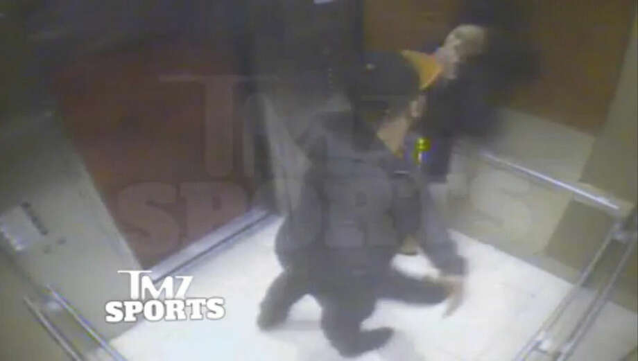 In this still image taken from a hotel security video released by TMZ Sports, Baltimore Ravens running back Ray Rice punches his fiancee, Janay Palmer, in an elevator at the Revel casino in Atlantic City, N.J., in February 2014. The Ravens terminated their contract with Rice Monday, Sept. 8, 2014, hours after the video surfaced on TMZ's website, and he was suspended indefinitely by the NFL. (AP Photo)