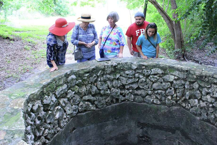 From left, Lois Heger, Lou Taylor, Patricia Osoria, Eddie Gutierrez and Samantha Damanda peer into the Blue Hole on the University of the Incarnate Word campus. The spring is known as the headwaters of the San Antonio River, and it only flows when water in the Edwards Aquifer reaches a certain level. The record is 703 feet, set in 1992. Photo: Brendan Gibbons / San Antonio Express-News