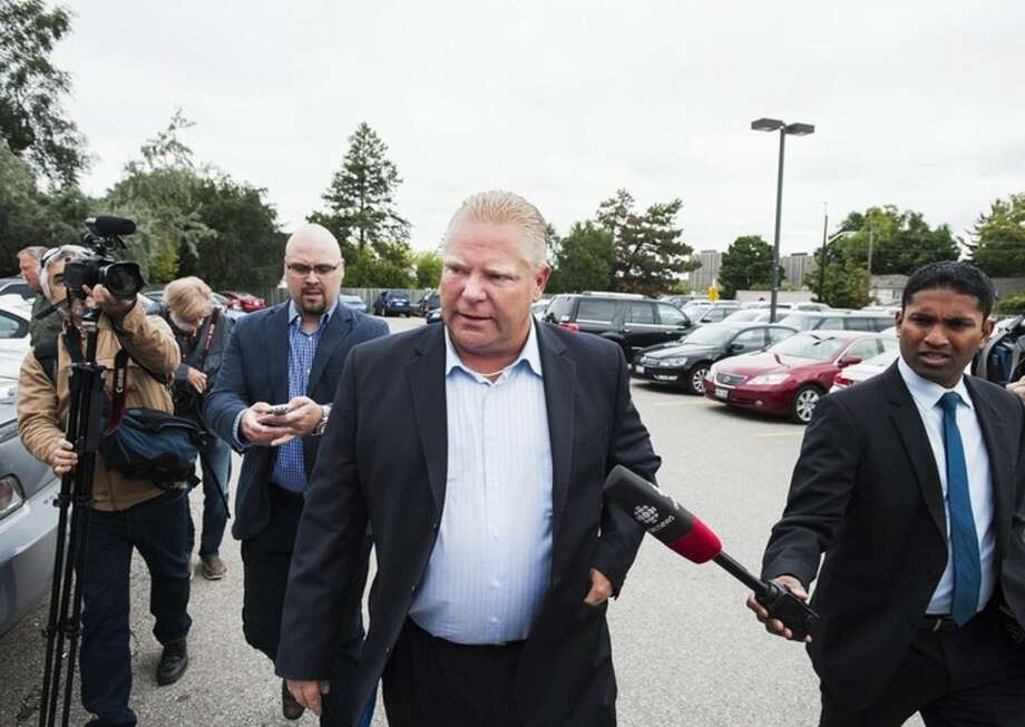 Doug Ford arrives at Humber River Hospital, Thursday Sept. 11, 2014, in Toronto, where his brother Toronto Mayor Rob Ford is undergoing tests to determine the nature of a tumor he has been diagnosed with after seeking treatment for abdominal pain. (AP Photo/The Canadian Press, Aaron Vincent Elkaim)