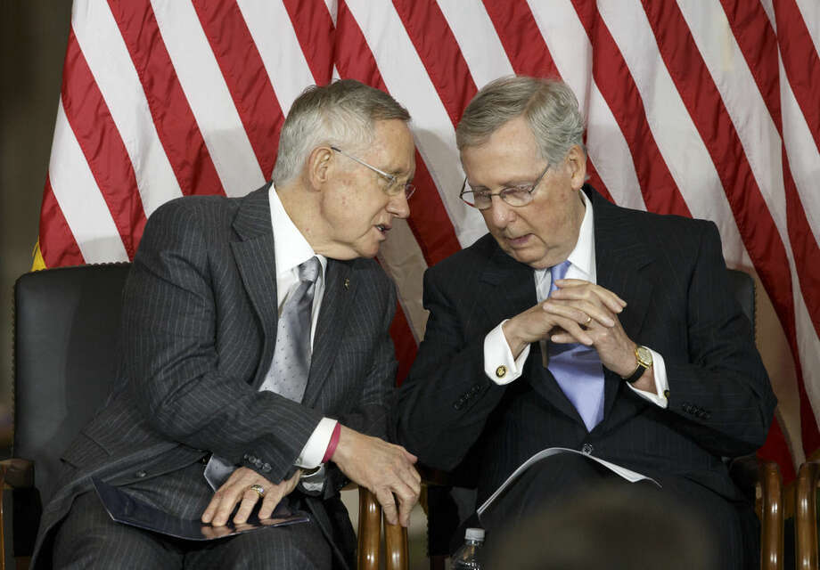 "Senate Majority Leader Harry Reid of Nev., left, talks with Senate Minority Leader Mitch McConnell of Ky., on Capitol Hill in Washington, Wednesday, Sept. 10, 2014, as Congress honored victims of the terror attacks of September 11, 2001, during a ""Fallen Heroes of 9/11 Gold Medal Ceremony"". (AP Photo/J. Scott Applewhite)"