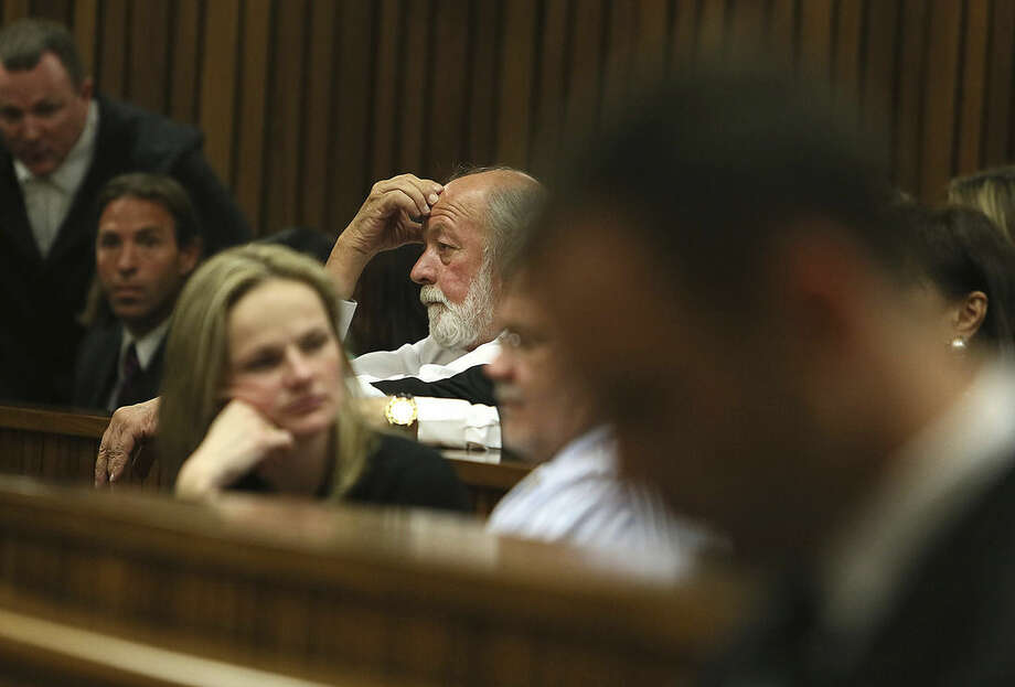 Barry Steenkamp, middle back, father of the late Reeva Steenkamp, listens to judgement in court in Pretoria, South Africa, Friday, Sept. 12, 2014. Judge Thokozile Masipa found Oscar Pistorius guilty of culpable homicide and an arms related charge. (AP Photo/Alon Skuy, Pool)