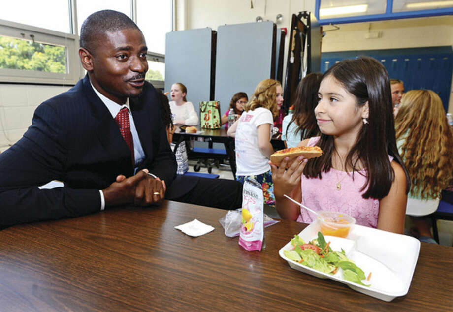 Hour photos/Erik TrautmannNew Nathan Hale Middle School Principal Albert Sachy meets with 6th grade students at lunch including Trisha Lopez.