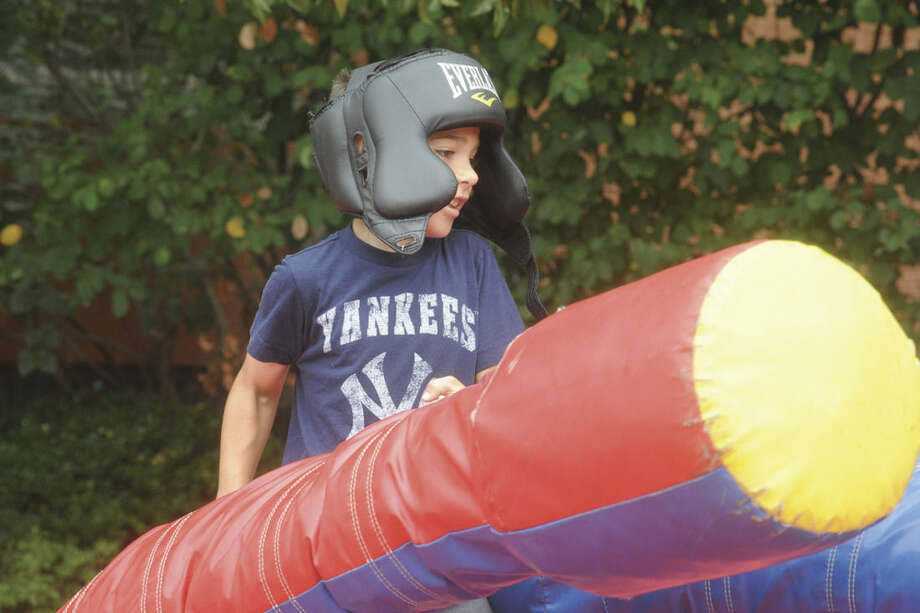 Frederick Scinto battles on an inflatable arena Sunday at the Blues Views and BBQ Festival in Westport. Hour photo/Matthew Vinci