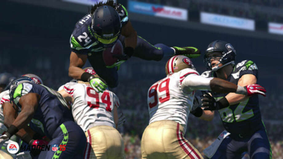 """In this photo provided by EA Sports, the Seattle Seahawks running back Marshawn Lynch leaps for yardage in """"Madden NFL 15"""" (EA Sports, for the Xbox One, PlayStation 4, Xbox 360, PlayStation 3, $59.99). (AP Photo/EA Sports)"""