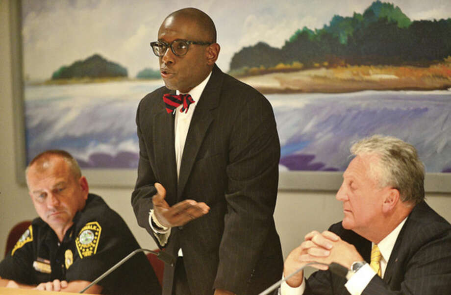 Hour photo/Erik TrautmannNAACP Norwalk Branch president Darnell Crosland sponsors a Town Hall Meeting at City Hall Thursday night to discuss views and concerns regarding recent national incidents including the shooting death of Michael Brown in Ferguson.