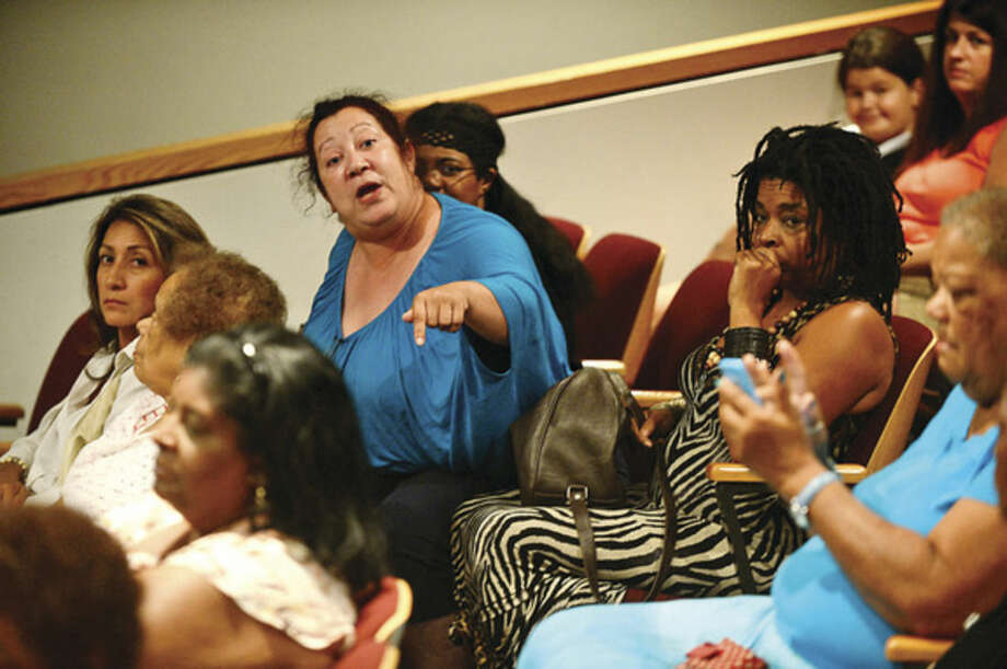 Hour photo / Erik Trautmann Norwalk Board of Education member Migdalia Rivas comments as The Norwalk Branch NAACP sponsors a Town Hall Meeting at City Hall Thursday night to discuss views and concerns regarding recent national incidents including the shooting death of Michael Brown in Ferguson.