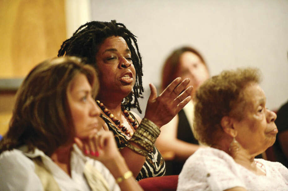 Hour photo / Erik Trautmann Members of the audience comment as The Norwalk Branch NAACP sponsors a Town Hall Meeting at City Hall Thursday night to discuss views and concerns regarding recent national incidents including the shooting death of Michael Brown in Ferguson.
