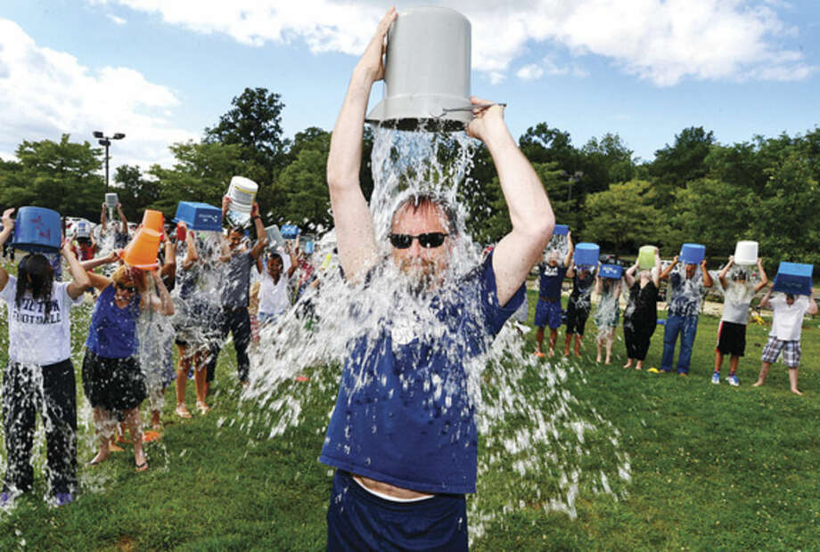 Hour photo/Erik TrautmannMiddlebrook Middle School staff and students, including Dean of Students Jory Higgins, honor retired teacher, Tom Everett, who is currently suffering from ALS, by doing the ALS Ice Bucket Challenge behind the school Thursday afternoon.