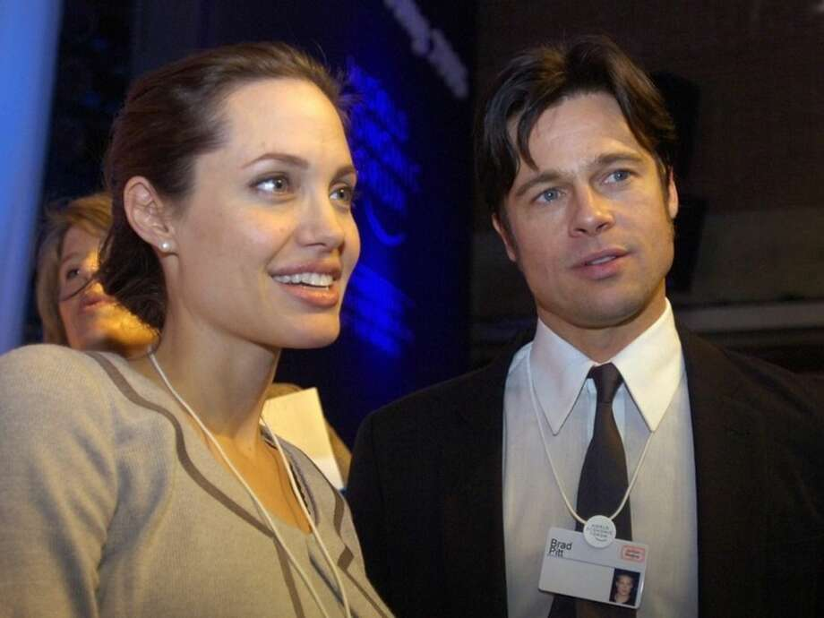 FILE - In this Thursday, Jan. 26, 2006, file photo, Angelina Jolie, left, and Brad Pitt attend the World Economic Forum in Davos, Switzerland. Jolie and Pitt were married Saturday, Aug. 23, 2014, in France, according to a spokesman for the couple. (AP Photo/Keystone, Walter Bieri, File)