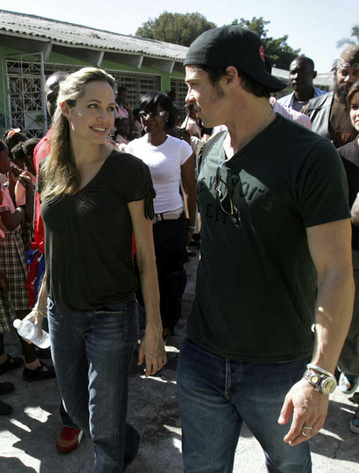 FILE - In this Friday, Jan. 13, 2006, file photo, Angelina Jolie and Brad Pitt tour the Immaculate Conception School, in Port au Prince, Haiti. Jolie and Pitt were married Saturday, Aug. 23, 2014, in France, according to a spokesman for the couple. (AP Photo/Brennan Linsley, File)
