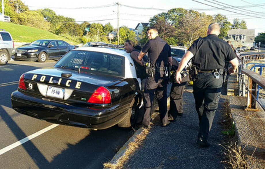 Photo by Robin SattlerNorwalk Police apprehend a suspect Monday evening in East Norwalk.
