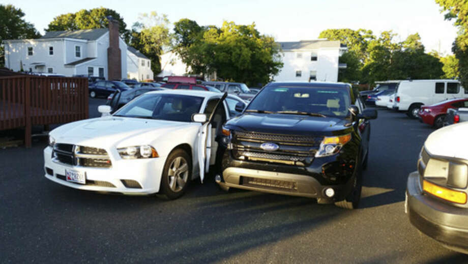 Photo by Robin SattlerAn undercover Norwalk Police truck, right, hits the car that was previously filled with suspects on Monday evening in East Norwalk.