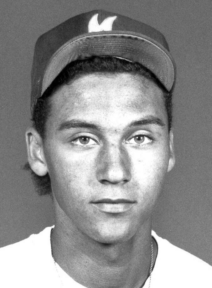 In this photo taken in the early 1990s, Kalamazoo Central baseball player Derek Jeter poses for a photo in Kalamazoo, Mich. A five-time World Series champion and sixth on the career hits list, Jeter, now 40, is set to retire after this season after spending two decades as the shortstop for the New York Yankees. (AP Photo/Kalamazoo Gazette-MLive Media Group) ALL LOCAL TELEVISION OUT; LOCAL TELEVISION INTERNET OUT
