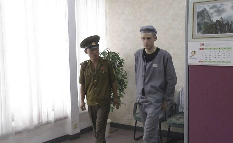 This image taken from video shows Matthew Miller in North Korea, Wednesday, Sept. 24, 2014. The American man recently sentenced by North Korea to six years of hard labor says he is digging in fields eight hours a day and being kept in isolation, but that so far his health isn't deteriorating. Under close guard and with only enough time to respond to one question, 24-year-old Matthew Miller spoke briefly to an Associated Press Video journalist at a Pyongyang hotel, where he had been brought to make a phone call to his family. (AP Photo/AP Video)