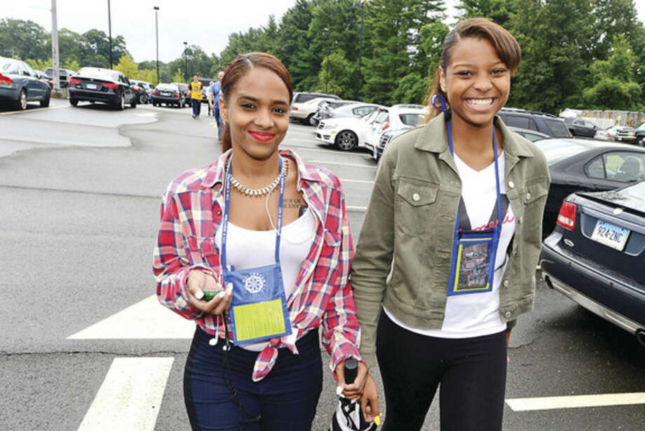Hour photo / Erik Trautmann Norwalk Community College students Tatiana Reyes and Simone Lewis aprticipate in the first Wellness Walk around campus with students and faculty.
