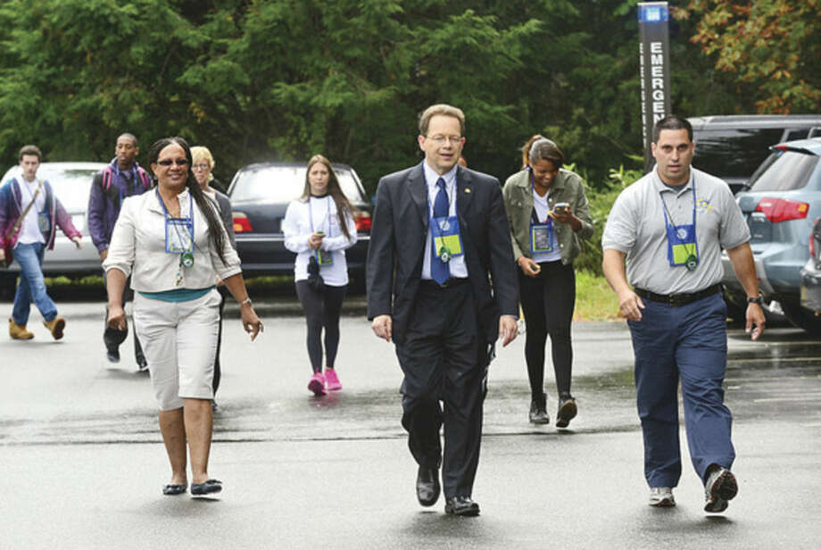 Hour photo / Erik Trautmann Norwalk Community College President David Levinson, Secretary of Student Actvities, Jennifer Osinowo, and Director of Excercise Science and Wellness, Paul Gallo, leads the first in a series of Wellness Walks around campus with students and faculty.