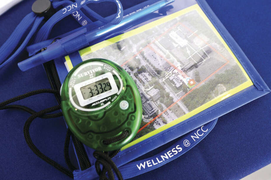 Hour photo / Erik Trautmann Partcipants in the Norwalk Community College Wellness Walks around campus are provided with a map and stop watch to track their progress.
