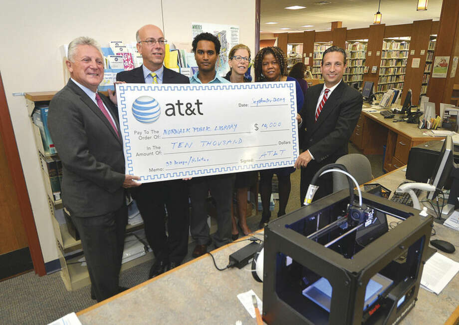 Hour Photo/Alex von Kleydorff Mayor Harry Rilling, AT & T's Harry Carey,Fairfield County Makers Guild President Vladimir Mariano Norwalk Public Library Director Christine Bradley, Assistant Director Sherelle Harris