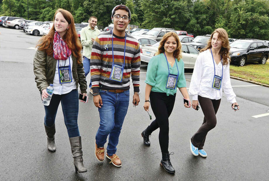 Hour photo / Erik Trautmann Norwalk Community College students join NCC President David Levinson leads the first in a series of Wellness Walks around campus Tuesday.