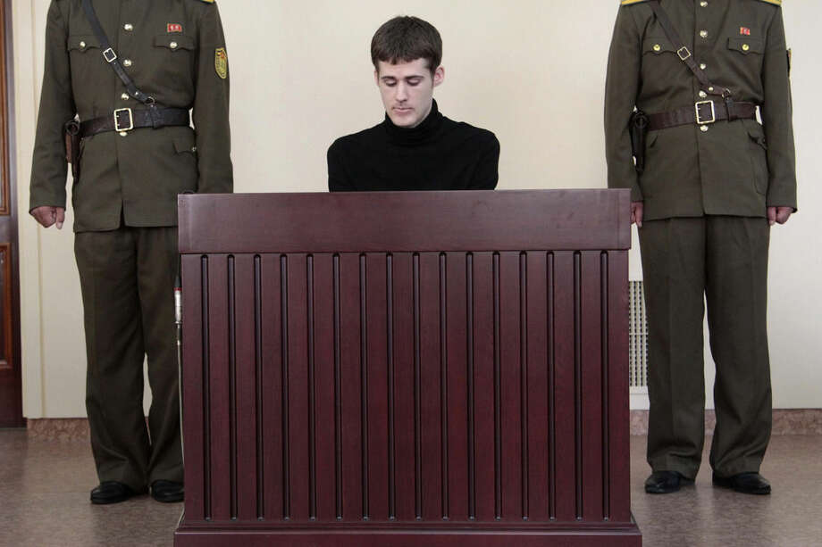 Matthew Miller, a U.S. citizen, sits before the Supreme Court during his trial in Pyongyang, North Korea, Sunday, Sept. 14, 2014. North Korea's Supreme Court on Sunday sentenced Miller to six years of hard labor for entering the country illegally and trying to commit espionage. (AP Photo/Kim Kwang Hyon)