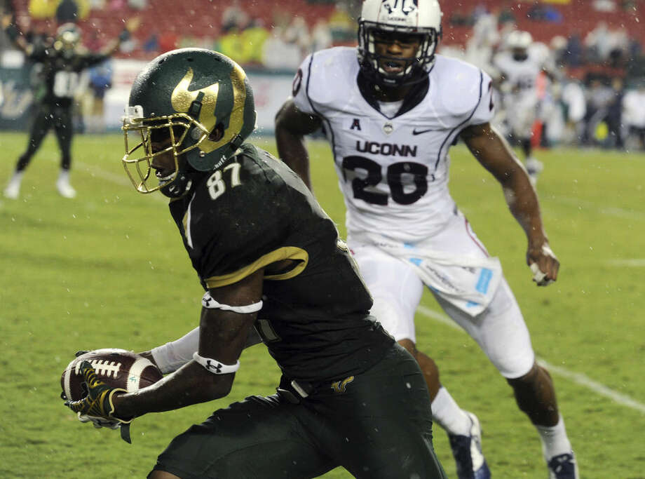 University of South Florida's Rodney Adams (87) heads for a touchdown against UConn, during a football game, Friday, Sept. 19, 2014 at Raymond James Stadium in Tampa, Fla. (AP Photo/Tampa Tribune, Andy Jones) ST. PETERSBURG OUT; LAKELAND OUT; BRADENTON OUT; MAGS OUT; LOCAL TELEVISION OUT; WTSP CH 10 OUT; WFTS CH 28 OUT; WTVT CH 13 OUT; BAYNEWS 9 OUT; THE TAMPA BAY TIMES OUT; LAKELAND LEDGER OUT; BRADENTON HERALD OUT; SARASOTA HERALD-TRIBUNE OUT; WINTER HAVEN NEWS CHIEF OUT
