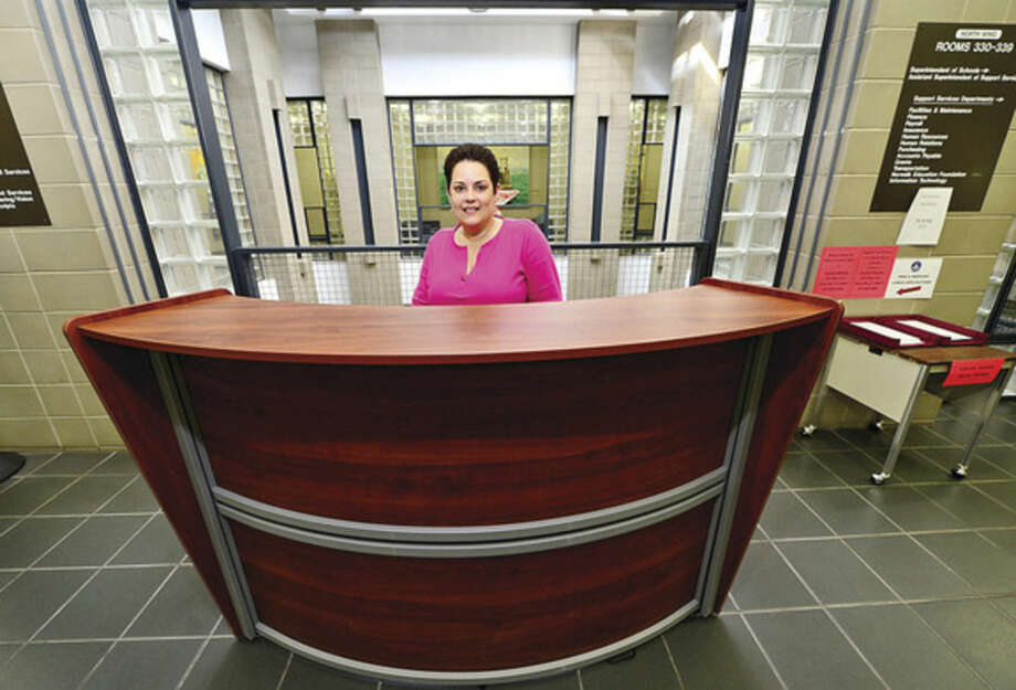 Hour photo/Erik TrautmannNatalie Alonzo mans the new 3rd floor customer service area at Norwalk City Hall. The desk was installed this year to help ease the customer service related issues for Norwalk Public Schools.