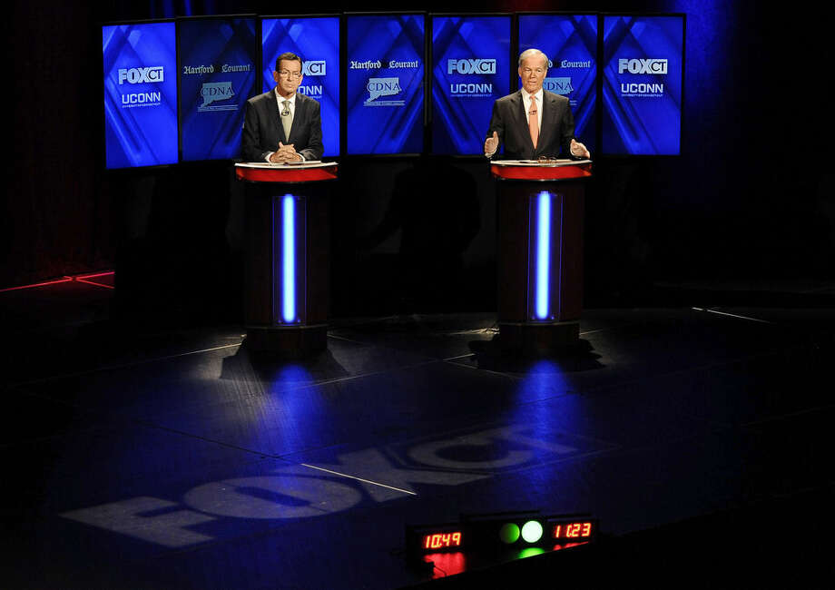 Republican candidate for governor Tom Foley, right, gestures as incumbent Democrat Gov. Dannel P. Malloy, left, listens during a live televised debate at the University of Connecticut, Thursday, Oct. 2, 2014, in Storrs, Conn. (AP Photo/Jessica Hill)