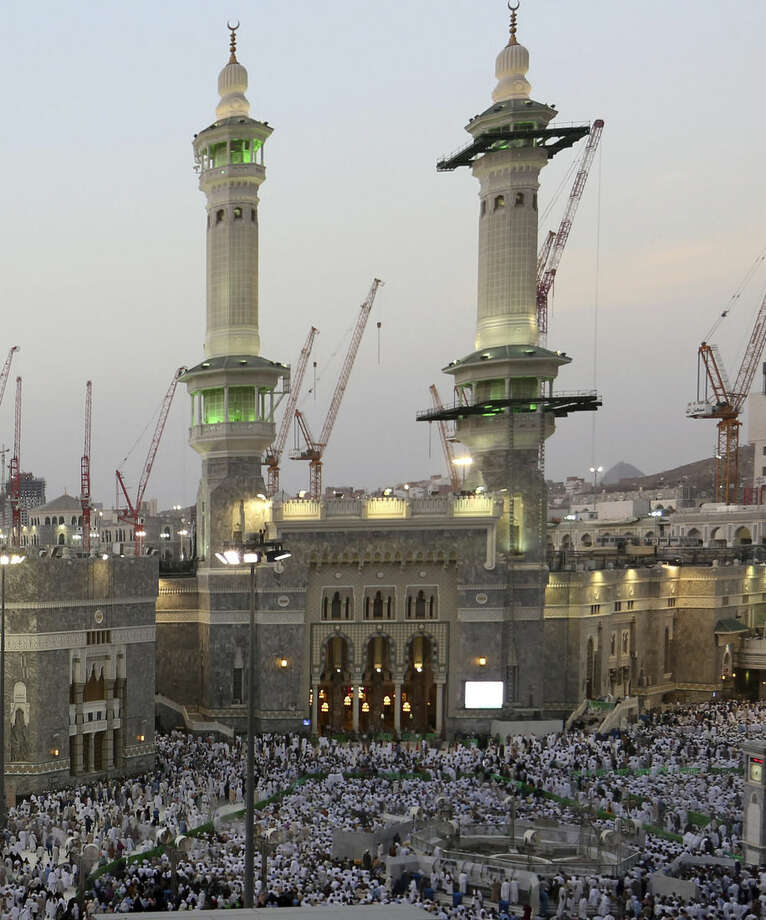 Muslim pilgrims pray outside the Grand Mosque, a day before Muslim's annual pilgrimage, known as the Hajj, in the Muslim holy city of Mecca, Saudi Arabia, Wednesday, Oct. 1, 2014. (AP Photo/Khalid Mohammed)