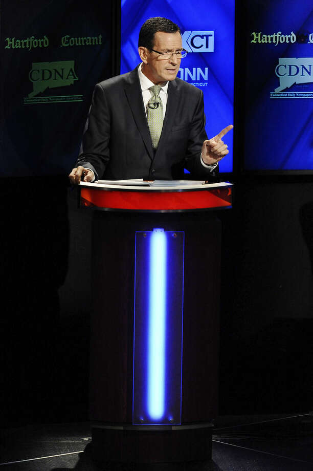 Incumbent Democrat Gov. Dannel P. Malloy, gestures during a live televised debate with Republican candidate for governor Tom Foley at the University of Connecticut, Thursday, Oct. 2, 2014, in Storrs, Conn. (AP Photo/Jessica Hill)