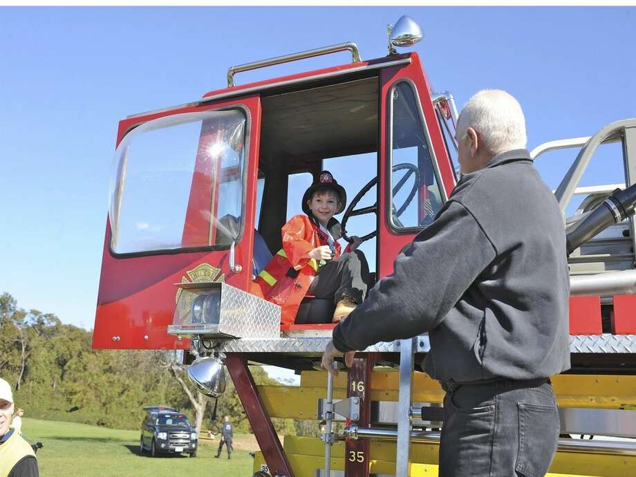Contributed photoA boy rides a firetruck at last year's Children's Connection Touch-A-Truck fundraiser. The 3rd Annual KIDZFEST Touch-A-Truck Fundraiser will be held from 10 a.m. to 3 p.m., Saturday at Taylor Farm Park, Norwalk.
